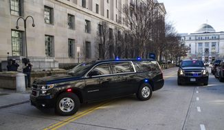 The motorcade for Attorney General William Barr arrives at the Department of Justice, Sunday, March 24, 2019, in Washington. Barr was expected to release his first summary of Mueller's findings on Sunday, people familiar with the process said, on what lawmakers anticipated could be a day of reckoning in the two-year probe into President Donald Trump and Russian efforts to elect him. Since receiving the report Friday, Barr has been deciding how much of it Congress and the public will see. (AP Photo/Alex Brandon)