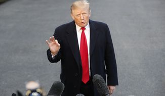 "President Donald Trump speaks with the media after stepping off Marine One on the South Lawn of the White House, Sunday, March 24, 2019, in Washington. The Justice Department said Sunday that special counsel Robert Mueller's investigation did not find evidence that President Donald Trump's campaign ""conspired or coordinated"" with Russia to influence the 2016 presidential election. (AP Photo/Pablo Martinez Monsivais)"