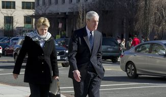 Special counsel Robert Mueller, and his wife Ann, walk to their car after attending services at St. John's Episcopal Church, across from the White House, in Washington, Sunday, March 24, 2019. Mueller closed his long and contentious Russia investigation with no new charges, ending the probe that has cast a dark shadow over Donald Trump's presidency. (AP Photo/Cliff Owen)