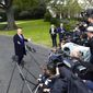 President Trump faces a wall of reporters and photographers during a brief question and answer session on the White House lawn. (Associated Press)