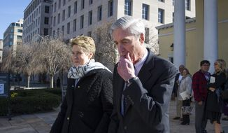 In this March 24, 2019, photo, special counsel Robert Mueller, and his wife Ann, depart St. John's Episcopal Church, across from the White House, in Washington. (AP Photo/Cliff Owen)
