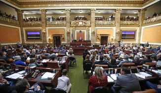 In this Jan. 28, 2019, file photo, the floor of the Utah House of Representatives is shown during the first day of the Utah legislative session, in Salt Lake City. In March 2019, the state legislature passed and Republican Gov. Gary Herbert has signed a law banning most abortions after 18 weeks of gestation. (AP Photo/Rick Bowmer, file) **FILE**