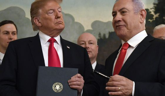 President Donald Trump listens as Israeli Prime Minister Benjamin Netanyahu, right, speaks in the Diplomatic Reception Room at the White House in Washington, Monday, March 25, 2019. Trump signed an official proclamation formally recognizing Israel's sovereignty over the Golan Heights. (AP Photo/Susan Walsh)