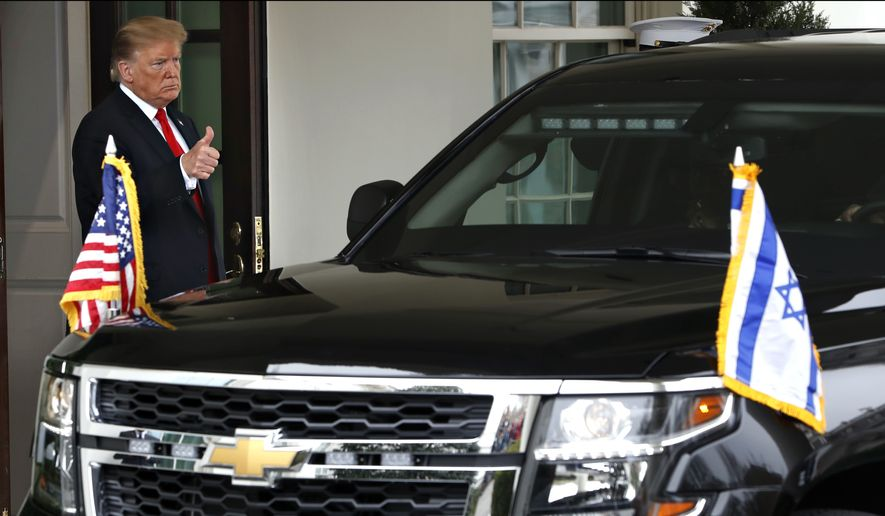President Donald Trump gives the thumbs up sign to Israeli Prime Minister Benjamin Netanyahu as his vehicle departs after their meeting at the White House, Monday March 25, 2019, in Washington. (AP Photo/Jacquelyn Martin)