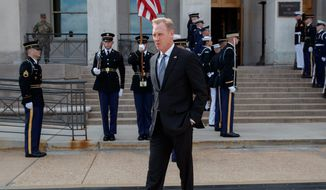 Acting Defense Secretary Patrick Shanahan walks to talk to the media before the arrival of French Defense Minister Florence Parly at the Pentagon, Monday, March 18, 2019. (AP Photo/Carolyn Kaster)