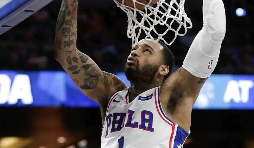 Philadelphia 76ers' Mike Scott makes an uncontested dunk against the Orlando Magic during the first half of an NBA basketball game, Monday, March 25, 2019, in Orlando, Fla. (AP Photo/John Raoux) ** FILE **