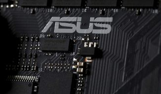 This Feb 23, 2019, photo shows the inside of a computer with the ASUS logo in Jersey City, N.J. Security researchers say hackers infected tens of thousands of computers from the Taiwanese vendor ASUS with malicious software for months last year through the company's online automatic update service. Kaspersky Labs said Monday, March 25, that the exploit likely affected more than 1 million computers from the world's No. 5 computer company, though it was designed to surgically install a backdoor in a much smaller number of PCs. (AP Photo/Jenny Kane)
