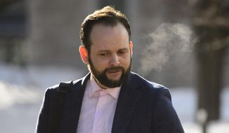 Joshua Boyle arrives at court in Ottawa on Monday, March 25, 2019. Boyle has gone on trial in Canada on charges that he repeatedly assaulted his wife. Boyle faces 19 charges, including sexual assault. A partial gag order was lifted at the trial started Monday, revealing that all but one of the 19 charges relate to his American wife, Caitlan Coleman of Stewartstown, Pa. Boyle and his wife were taken hostage in 2012 by a Taliban-linked group while on a backpacking trip in Afghanistan. The couple had three children during their five years in captivity. The family was rescued in 2017 by Pakistani forces. (Sean Kilpatrick/The Canadian Press via AP)