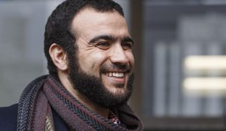 Former Guantanamo Bay prisoner Omar Khadr leaves court in Edmonton on Monday, March 25, 2019. A judge ruled Monday that that a war crimes sentence for former Guantanamo Bay prisoner Omar Khadr has expired.  Monday's ruling means he no longer faces the threat of returning to prison.   (Jason Franson/The Canadian Press via AP)