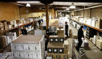In this Jan. 31, 2019, photo, orders are prepared for distribution at Free Run Wine Merchants in Richmond, Va. Amidst growth, Free Run Wine Merchants maintains focus on small, family-run wineries. (Mark Gormus/Richmond Times-Dispatch via AP)