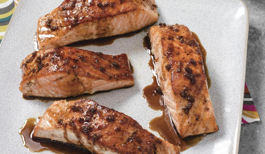 """This undated photo provided by America's Test Kitchen in March 2019 shows Sweet And Tangy Glazed Salmon in Brookline, Mass. This recipe appears in """"The Complete Cookbook for Young Chefs."""" (Carl Tremblay/America's Test Kitchen via AP)"""