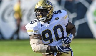 In this Saturday, Sep. 10, 2016, photo, Georgia Tech defensive lineman Brandon Adams reacts during the second half of an NCAA football game against Mercer, in Atlanta. Adams, a rising senior who was expected to be a key member of Georgia Tech's defensive line under new coach Geoff Collins, died at the age of 21, the school announced Sunday, March 24, 2019. Adams had been going through offseason workouts and was preparing for the start of spring practice when he died on campus Saturday. No cause was given. (AP Photo/Danny Karnik)