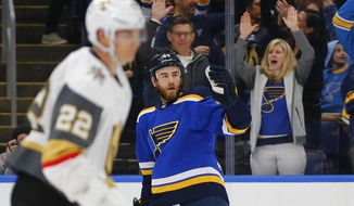 St. Louis Blues' Ryan O'Reilly (90) celebrates after scoring a goal against the Vegas Golden Knights during the second period of an NHL hockey game Monday, March 25, 2019, in St. Louis. (AP Photo/Dilip Vishwanat)