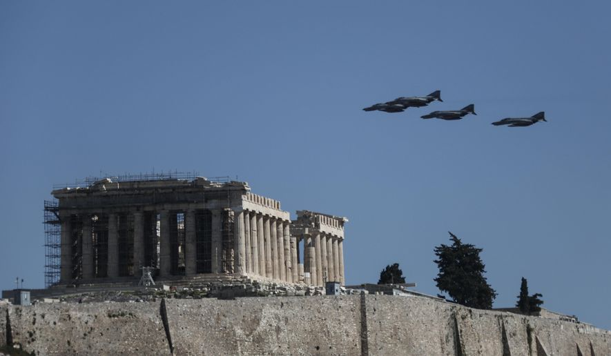 Military aircraft fly over the temple of the Parthenon during a parade in Athens, on Monday March 25, 2019. The parade commemorates Greek Independence Day, which marks the start of the war of independence in 1821 against the 400-year Ottoman rule. (AP Photo/Yorgos Karahalis)
