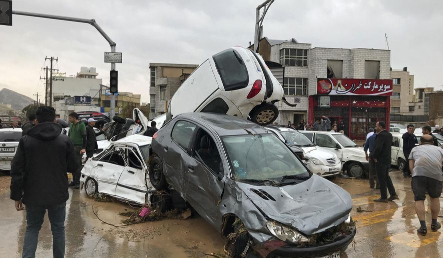 Vehicles are piled up on a street after a flash flood in the southern city of Shiraz, Iran, Monday, March 25, 2019. Iranian state TV reported that flash floods have killed at least 11 people and injured 15 in the country's south. The provinces of Fars, Kurdistan, Qom and Isfahan are also on alert for imminent flooding. (AP Photo/Amin Berenjkar/Mehr News Agency)