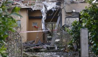 Damage to a house hit by a rocket is seen in Mishmeret, central Israel, Monday, March 25, 2019. An early morning rocket from the Gaza Strip struck a house in central Israel on Monday, wounding several people, an Israeli rescue service said, in an eruption of violence that could set off another round of violence shortly before the Israeli election. (AP Photo/Ariel Schalit)