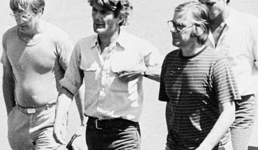 In this March 11, 1982 photo, from left, Jan Cornelius Kuiper, director, Koos Koster, producer, Johannes Willemsen, cameraman, and Hans ter Laan, soundman walk north of the capital, San Salvador, days before they were killed in El Salvador. Calls are mounting for Col. Mario Reyes Mena, a former Salvadoran army colonel, to be brought to justice for the killings. (AP Photo)