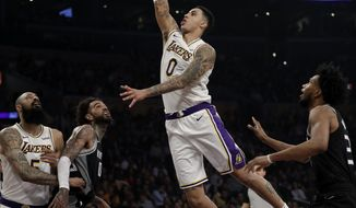 Los Angeles Lakers' Kyle Kuzma (0) scores against the Sacramento Kings during the first half of an NBA basketball game Sunday, March 24, 2019, in Los Angeles. (AP Photo/Marcio Jose Sanchez)