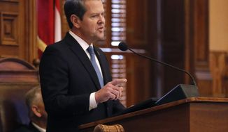 File-This Jan. 17, 2019, file photo shows Georgia Gov. Brian Kemp delivering his first State of the State address, in Atlanta. Legislation authorizing Republican Gov. Kemp to pursue a Medicaid waiver was approved by a state House panel Wednesday, potentially giving Georgia more flexibility to use federal funding but also capping who's covered by an expansion. Georgia is one of 14 states that haven't fully expanded Medicaid under the 2010 Affordable Care Act, also known as Obamacare. It called for Medicaid coverage for those making slightly above the federal poverty level. (Bob Andres/Atlanta Journal-Constitution via AP, File)