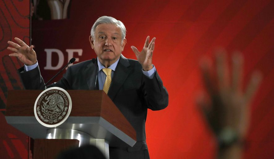 FILE - In this Friday, March 8, 2019 file photo, Mexican President Andres Manuel Lopez Obrador answers questions from journalists at his daily 7 a.m. press conference at the National Palace in Mexico City. Lopez Obrador said he sent a letter to Spain and the Vatican on March 1, asking them to apologize for the conquest of the Americas five centuries ago. (AP Photo/Marco Ugarte, File)