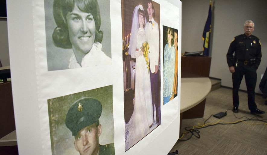 Photos of Linda and Clifford Bernhardt, who were killed in 1973, are displayed at a press conference at the Yellowstone County administrative offices in Billings, Montana on Monday, March 25, 2019. Yellowstone County Sheriff Mike Linder, pictured at right, says authorities have identified the couple's now-deceased killer. (AP Photo/Matthew Brown)