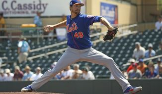 FILE - In this March 12, 2019, file photo, New York Mets pitcher Jacob deGrom (48) pitches during the first inning of a spring training baseball game against the Miami Marlins, in Jupiter, Fla. deGrom is expected to start Opening Day against the Washington Nationals. (David Santiago/Miami Herald via AP, File)