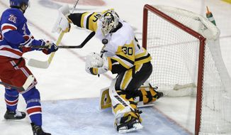 Pittsburgh Penguins goaltender Matt Murray (30) blocks a shot by New York Rangers center Brett Howden (21) with his body during the third period of an NHL hockey game in New York, Monday, March 25, 2019. The Penguins won 5-2. (AP Photo/Kathy Willens)