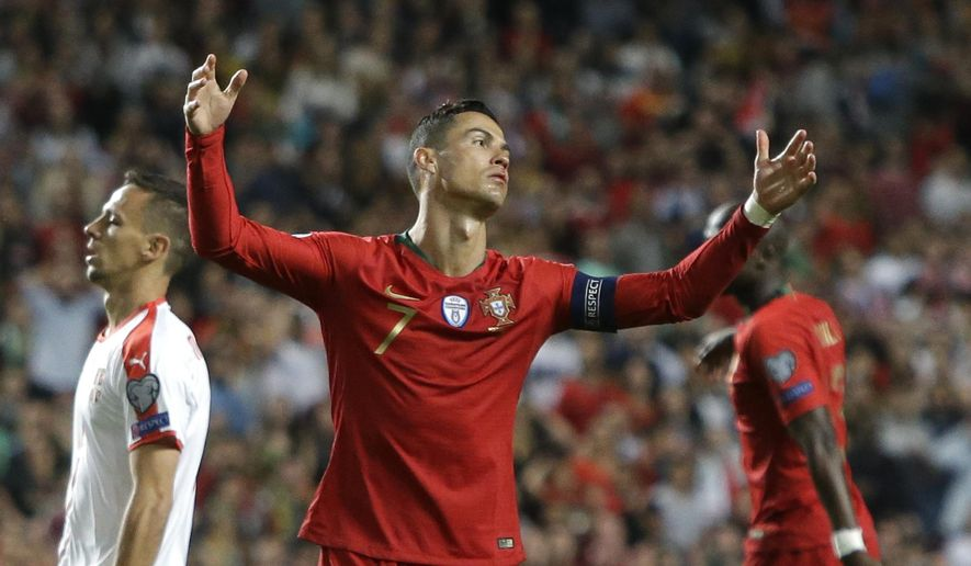 Portugal's Cristiano Ronaldo reacts during the Euro 2020 group B qualifying soccer match between Portugal and Serbia at the Luz stadium in Lisbon, Portugal, Monday, March 25, 2019. (AP Photo/Armando Franca)