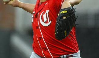 Cincinnati Reds' Tanner Roark pitches during the first inning of an exhibition baseball game against the Atlanta Braves, Monday, March 25, 2019, in Atlanta. (AP Photo/John Amis)