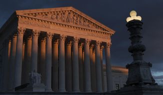 The Supreme Court is seen at sunset in Washington. (AP Photo/J. Scott Applewhite, File)