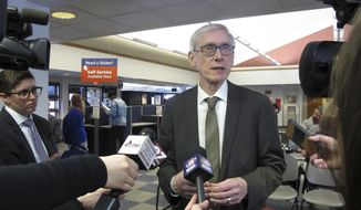 Wisconsin Gov. Tony Evers speaks to reporters Monday, March 25, 2019, in Madison, Wis. Evers moved quickly after last week's order to rescind 82 of former Republican Gov. Scott Walker's appointments that the state Senate confirmed during the lame-duck session. And Attorney General Josh Kaul, at Evers' order, moved to withdraw Wisconsin from a multi-state lawsuit seeking repeal of the Affordable Health Care Act, a power taken away from him during the lame-duck session. (AP Photo/Scott Bauer).