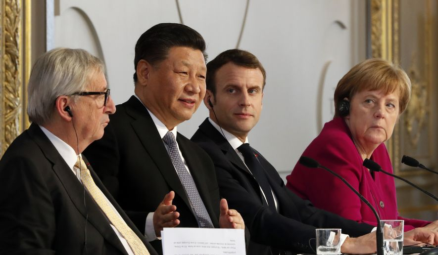 French President Emmanuel Macron, 2nd right, Chinese President Xi Jinping, German Chancellor Angela Merkel and European Commission President Jean-Claude Juncker, left, hold a press conference at the Elysee presidential palace in Paris, Tuesday, March 26, 2019. Xi Jinping is meeting with the leaders of France, Germany and the European Commission, as European countries seek to boost relations with China while also putting pressure over its trade practices. (AP Photo/Thibault Camus, Pool) **FILE**