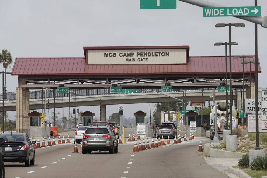 The entrance to Marine Corps base Camp Pendleton is seen Tuesday, Sept. 22, 2015, in Oceanside, Calif. (AP Photo/Gregory Bull) ** FILE **
