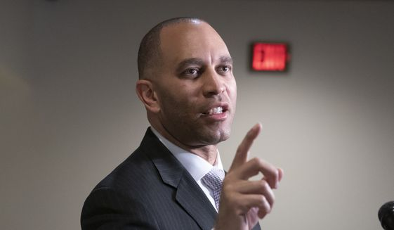 Rep. Hakeem Jeffries, D-N.Y., the House Democratic Caucus chair, fends off reporters' questions about President Donald Trump and the Mueller report, at the Capitol in Washington, Monday, March 25, 2019. (AP Photo/J. Scott Applewhite) ** FILE **