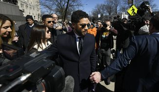 """Actor Jussie Smollett leaves Cook County Court after his charges were dropped Tuesday, March 26, 2019, in Chicago. Prosecutors on Tuesday abruptly dropped all charges against Smollett, defense attorneys said, apparently abandoning the case barely five weeks after the """"Empire"""" actor was accused of lying to police about being the target of a racist, anti-gay attack in downtown Chicago. (AP Photo/Paul Beaty)"""