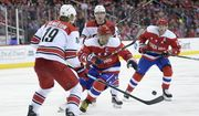 Washington Capitals left wing Alex Ovechkin (8), of Russia, battles for the puck against Carolina Hurricanes defenseman Dougie Hamilton, left, and right wing Andrei Svechnikov (37) during the second period of an NHL hockey game, Tuesday, March 26, 2019, in Washington. Aisles seen is Washington Capitals center Nicklas Backstrom, back right. (AP Photo/Nick Wass)