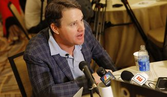 Washington Redskins head coach Jay Gruden speaks to the media during the NFC/AFC coaches breakfast during the annual NFL football owners meetings, Tuesday, March 26, 2019, in Phoenix. (AP Photo/Matt York)