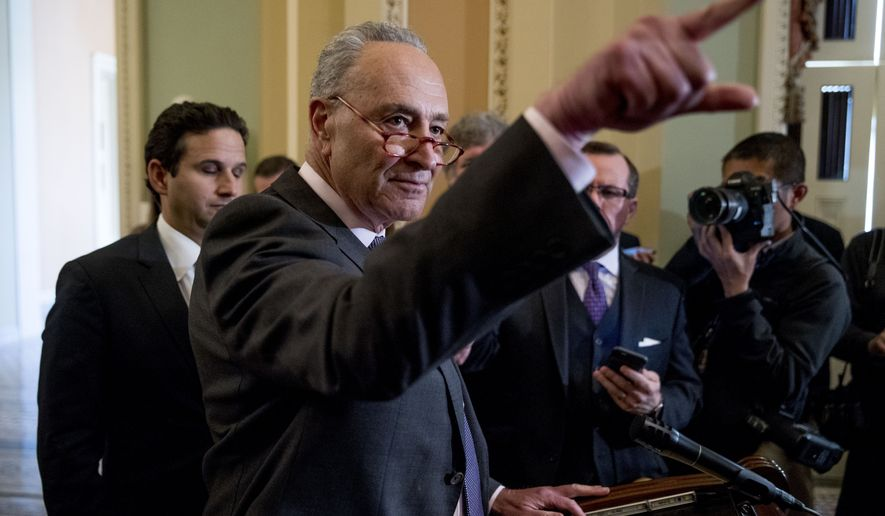 Senate Minority Leader Sen. Chuck Schumer of N.Y., calls on a member of the media following a Senate policy luncheon on Capitol Hill in Washington, Tuesday, March 26, 2019. (AP Photo/Andrew Harnik)