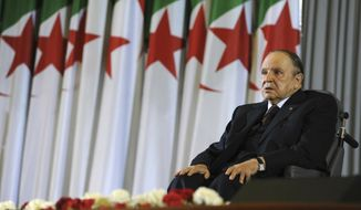 FILE - In this April 28, 2014 file photo, Algerian President Abdelaziz Bouteflika sits in a wheelchair after taking oath as President, in Algiers. Algeria's powerful army chief said Tuesday March 26, 2019 that he wants to trigger the constitutional process that would declare President Abdelaziz Bouteflika unfit for office, after more than a month of mass protests against the ailing leader's long rule. (AP Photo/Sidali Djarboub, File)
