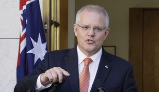 "In this Feb. 13, 2019, file photo Australian Prime Minister Scott Morrison addresses media at Parliament House in Canberra. Morrison, on Tuesday, March 26, 2019, accused an influential minor political party of trying to ""sell Australia's gun laws to the highest bidders"" by asking the U.S. gun lobby for donations. (AP Photos/Rod McGuirk, File)"