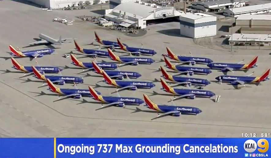 This Monday, March 25, 2019, image made from a video provided by KCAL9/CBSLA shows several Southwest Airlines Boeing 737 Max planes parked at the airport in Victorville, Calif. Southwest joins American Airlines in canceling dozens of flights daily as Boeing deals with the worldwide grounding of the aircraft following two deadly crashes. On Saturday, Southwest began to ferry all its Max aircraft to the Victorville facility, without passengers, to free up space at the airports where they had been parked. (KCAL9/CBSLA via AP)
