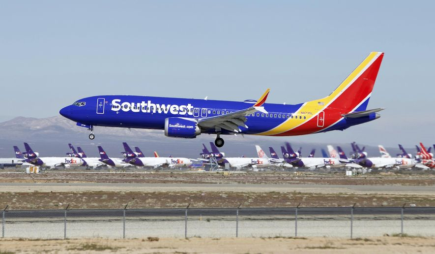 In this Saturday, March 23, 2019, photo, a Southwest Airlines Boeing 737 Max aircraft lands at the Southern California Logistics Airport in the high desert town of Victorville, Calif. Southwest, which has 34 Max aircraft, is making cancellations five days in advance, with an average of 130 daily cancellations. (AP Photo/Matt Hartman)