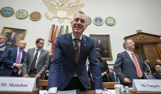 Acting Defense Secretary Patrick Shanahan and David Norquist, far right, the Defense Department's budget chief, arrive to testify at a House Armed Services Committee hearing on the fiscal year 2020 Pentagon budget, on Capitol Hill in Washington, Tuesday, March 26, 2019. Lawmakers are concerned about military construction projects that could lose funding this year to pay for President Donald Trump's border wall. (AP Photo/J. Scott Applewhite)