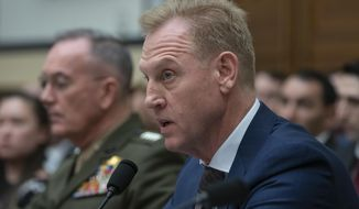 Acting Defense Secretary Patrick Shanahan, joined at left by Chairman of the Joint Chiefs of Staff Gen. Joseph F. Dunford, testifies at a House Armed Services Committee hearing on the fiscal year 2020 Pentagon budget, on Capitol Hill in Washington, Tuesday, March 26, 2019. Lawmakers are concerned about military construction projects that could lose funding this year to pay for President Donald Trump's border wall. (AP Photo/J. Scott Applewhite)