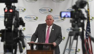 Meridian Township Manager Frank Walsh speaks during a press conference Tuesday, March 26, 2019, in Meridian Township, Mich., after the department announced the end of their investigation on the 2004 complaint by Brianne Randall-Gay regarding abuse by Larry Nassar. Officials in Meridian Township, publicly apologized to the victim, Brianne Randall-Gay, a year ago, after Nassar was sentenced to decades to prison for molesting girls and young women. They also took an extraordinary step, hiring an investigator to learn more about how police handled her complaint. (Matthew Dae Smith