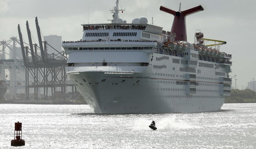 In this June 20, 2016, file photo, a jet skier passes in front of the Carnival Sensation cruise ship as it leaves PortMiami, in Miami Beach, Fla. (AP Photo/Lynne Sladky, File) **FILE**