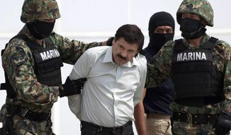 """FILE - In this Feb. 22, 2014 file photo, Joaquin """"El Chapo"""" Guzman, center, is escorted to a helicopter in handcuffs by Mexican navy marines at a hanger in Mexico City, after he was captured overnight in the beach resort town of Mazatlan. Defense attorneys asked a federal judge Tuesday, March 26, 2019, to grant a new trial to El Chapo, saying jurors improperly followed media coverage of the sensational drug conspiracy case. (AP Photo/Eduardo Verdugo, File)"""
