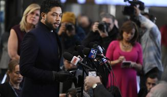 Actor Jussie Smollett talks to the media before leaving Cook County Court after his charges were dropped Tuesday, March 26, 2019, in Chicago. (AP Photo/Paul Beaty)