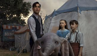 """This image released by Disney shows Colin Farrell, Nico Parker and Finley Hobbins in a scene from """"Dumbo."""" (Disney via AP)"""