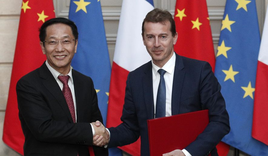 President of Airbus's commercial aircraft business, Guillaume Faury, right, and Chairman of China Aviation Supplies Co. (CASC) Jia Baojun, left, shake hands during an agreement signing ceremony at the Elysee Palace in Paris, France, Monday, March 25, 2019. (Yoan Valat/Pool Photo via AP) ** FILE **